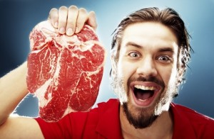 happy-man-holding-raw-steak